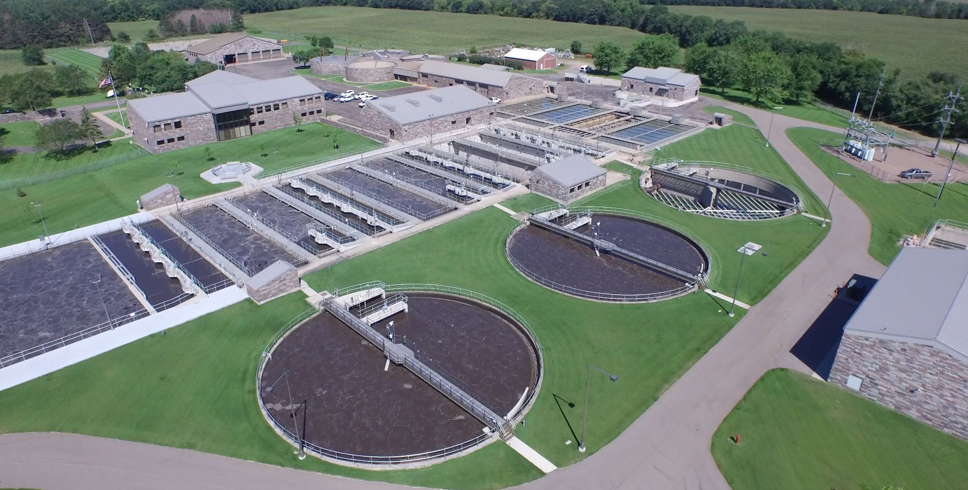 Aerial Photo of buildings, water tanks, pools of water, and wastewater treatment equipment