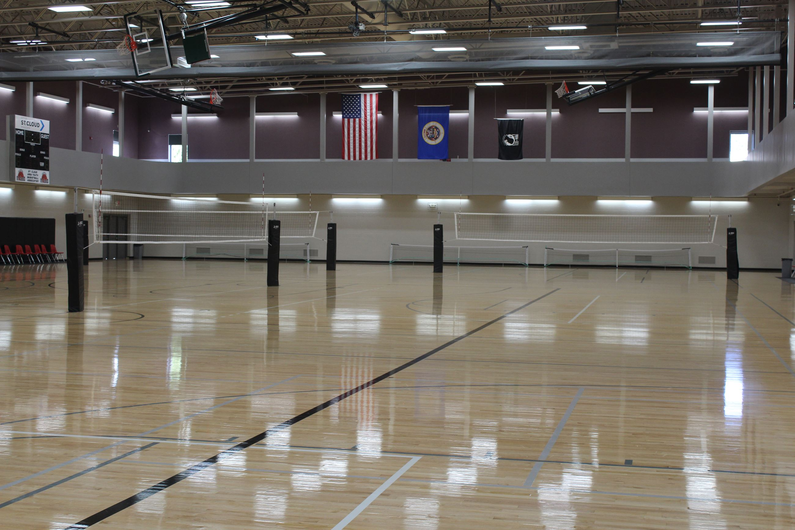 Whitney Recreation Center gym set up with three volleyball nets