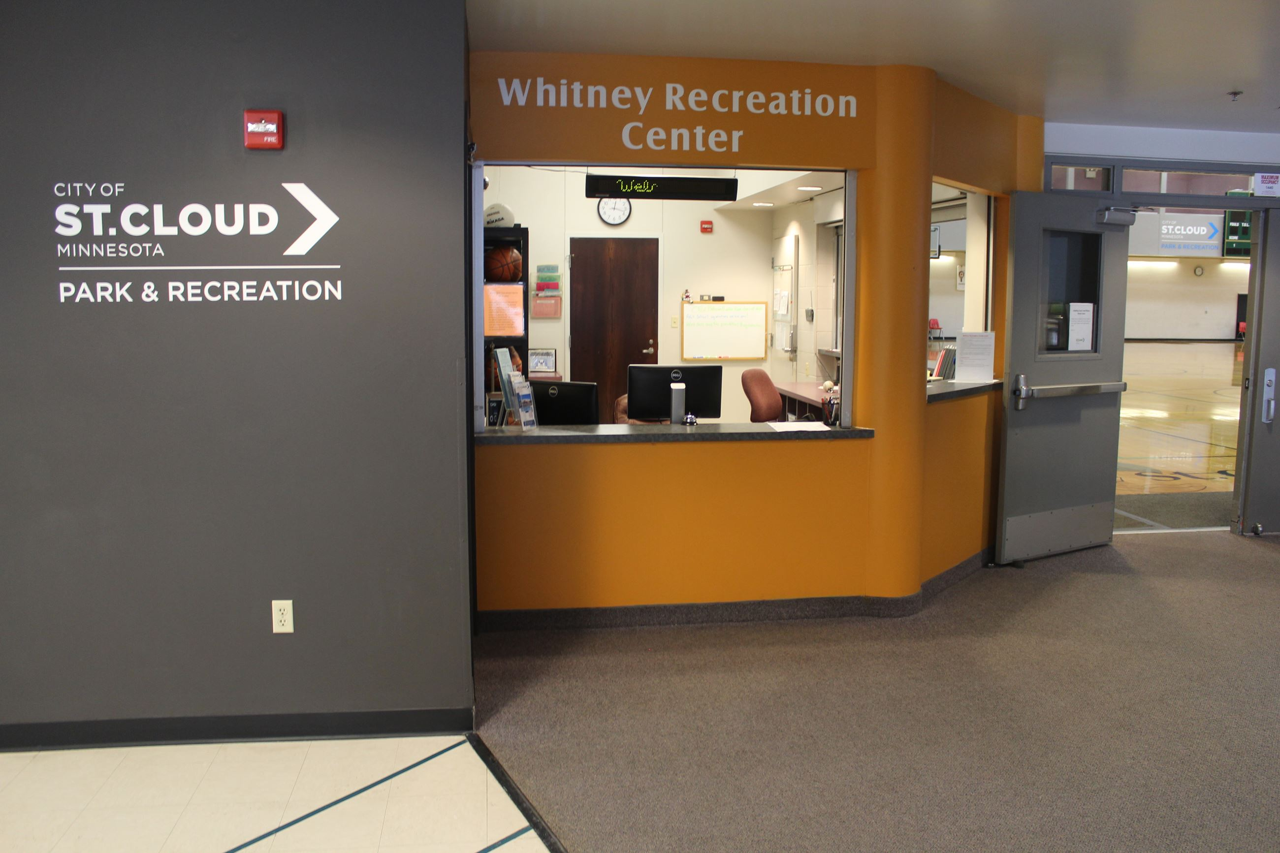 Photo shows the Whitney Recreation Gym Office window, just to the right of the City's logo