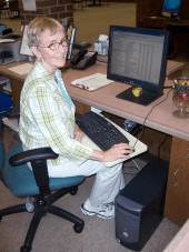 A volunteer working on the computer