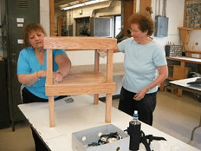 Two women working in the woodshop