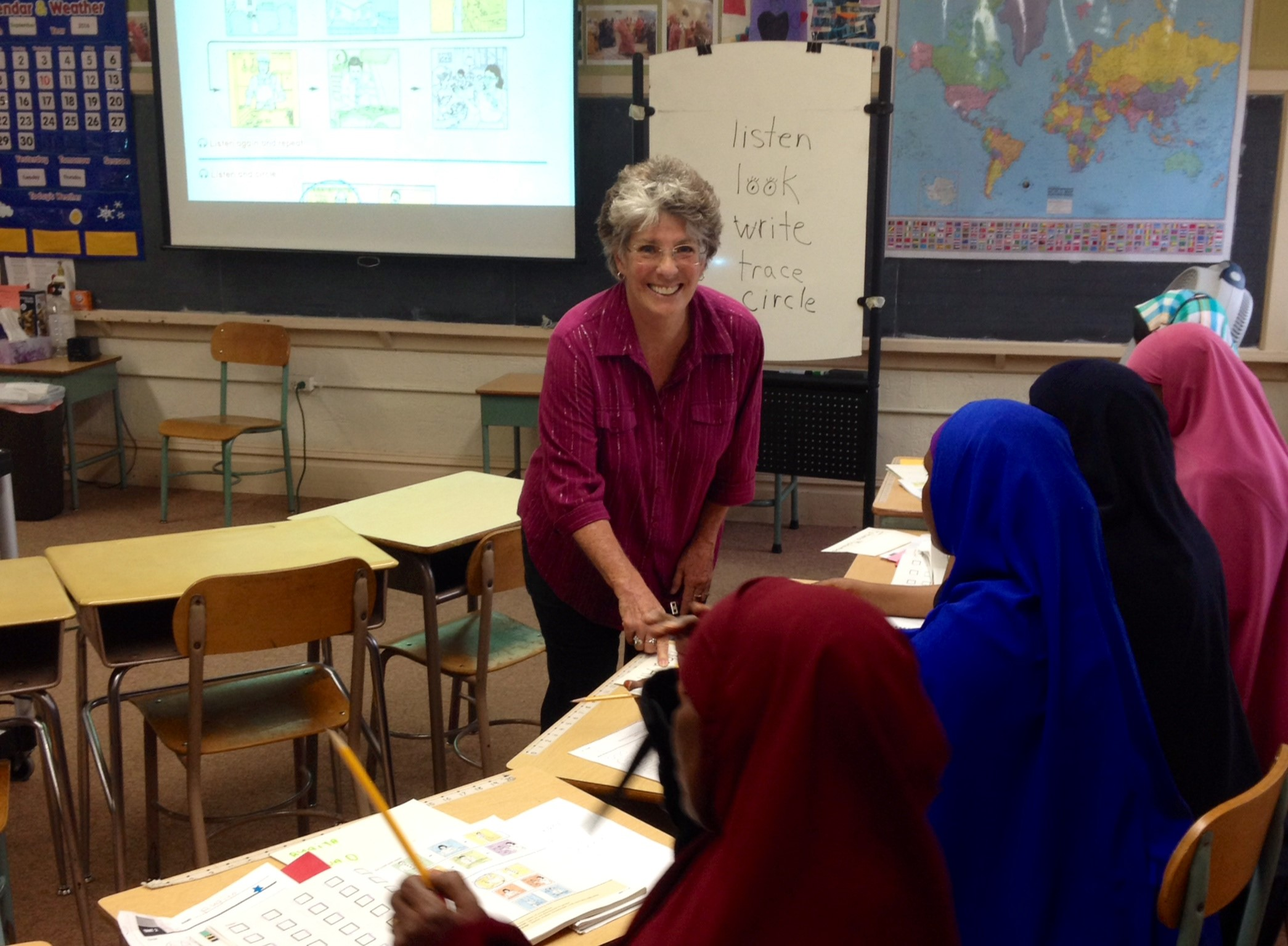 RSVP Volunteer, Nancy, working with students in a classroom.